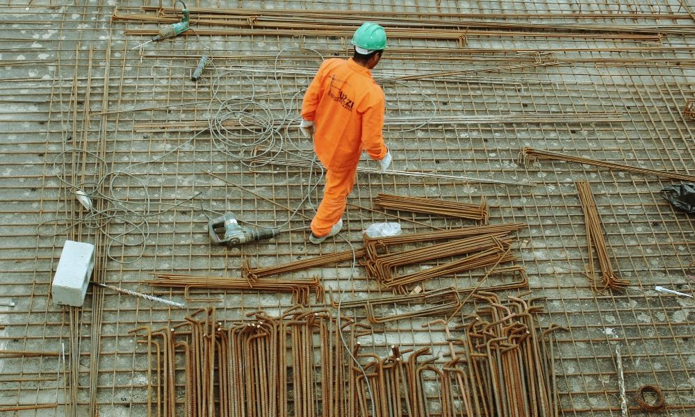 man on construction site with potential workers comp case