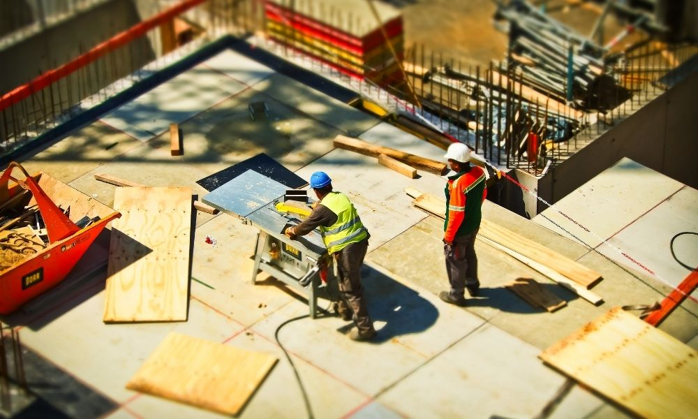 birds eye view of a construction site with two workers