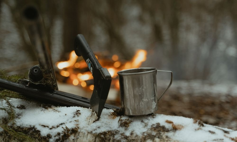 hunting tools by a campfire