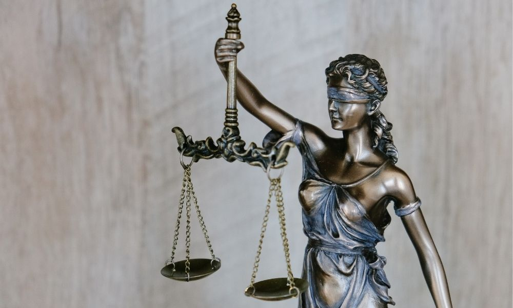 figure holding justice scales